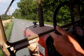 A tractor driver's view of the road, Warwickshire. - Justin Tallis - 2000s,2006,a,Agricultural,agriculture,arable,at,board,capitalism,capitalist,cereal,coming,corn,country,countryside,crop,crops,drive,driven,driver,drivers,driving,EBF economy,farm,farm worker,farm work