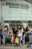 Holidaymakers arriving at Birmingham International Airport. - Justin Tallis - 10-08-2006