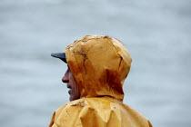 On board a fishing trawler in the Irish Sea. The four-man crew work on one of the last remaining trawlers in Fleetwood, Lancashire. - Justin Tallis - 2000s,2006,at,board,boat,boats,common,crew,crewman,crewmen,crewmenmaritime,EARNINGS,EBF,EBF Economy,Economic,Economy,EQUALITY,fisheries,fisherman,fishermen,fishery,fishing,Fishing Industry,Income,INCO