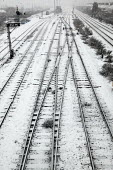 Snow covered tracks on the railway lines into Newport Station, South Wales. - Justin Tallis - 2000s,2006,cold,EBF Economy,in,infrastructure,line,lines,network,not,precipitation,rail,railway,Railway Line,RAILWAYS,season,seasons,snow,snowed,snowfall,snowing,Station,STATIONS,stop,stopped,track,tr