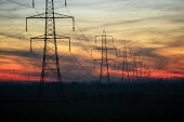 Electricity pylons at sunset. Near Newport, South Wales. - Justin Tallis - 04-02-2007