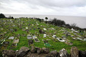 Graveyard by the sea near to Watchet in the south west of England. - Justin Tallis - 2000s,2007,cemeteries,cemetery,church,churches,coast,coastal,coastline,coastlines,coasts,Council Services,Council Services,eni environmental issues,gave,grave,graves,Graveyard,Graveyards,local authori