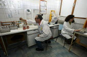 Scientists examining blood samples in the Pathology Laboratory of a hospital in Aiud, Romania. - Justin Tallis - 31-03-2007
