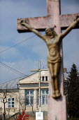 Jesus dies on the cross and the Stations of the Cross outside a convent in Jibou, Romania. - Justin Tallis - 17-03-2007
