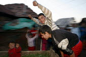 Young men cheering in the town of Jibou, Romania. - Justin Tallis - 13-04-2007