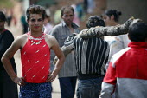 A Roma gypsy transvestite walking down the street, Jibou, Romania - Justin Tallis - 15-04-2007