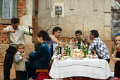 An afternoon celebration at Easter, in the town of Jibou, Romania. - Justin Tallis - &,2000s,2007,ACE,ADDICTION,ADDICTIVE,adult,adults,Alcohol,alcoholic,ALCOHOLICS,ALCOHOLISM,BAME,BAMEs,beer,beers,beverage,beverages,BME,bme minority ethnic,bmes,boy,boys,celebrate,celebrating,celebrati
