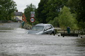 A four by four is washed across the road in rising flood waters in Welford on Avon, Warwickshire. A months worth of rain has fallen in just a few hours leading to severe flooding. - Justin Tallis - 22-07-2007