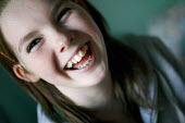 A happy young girl with braces. - Justin Tallis - ,2000s,2007,brace,braces,buck,child,CHILDHOOD,children,dental,dentist,dentistry,DENTISTS,EMOTION,EMOTIONAL,EMOTIONS,female,females,funny,girl,girls,happiness,happy,HEA health,Humor,HUMOROUS,HUMOUR,jok