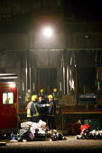 Firemen working through the night at a suspected arson at a warehouse in Warwickshire. Four firefighters are believed to have died tackling the blaze. Packhouse at Bomfords Ltd Atherstone Industrial E... - Justin Tallis - 2000s,2007,999,accident,accidental,ACCIDENTS,adult,adults,and,arson,blaze,building,BUILDINGS,cold,crew,damage,damaged,danger,dangerous,death,deaths,DIA accidents accident,Died,Emergency Services,fire,