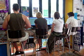 Travellers using computers in a backpackers internet cafe. Sydney, Australia. - Justin Tallis - 17-12-2007