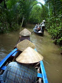 Travelling by boat along the Mekong Delta. My Tho in the Tien Giang Province of South Vietnam. - Justin Tallis - 30-05-2008