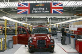 The end of the production line at London Taxi International manufacturing plant in Coventry where the iconic black cab is made. LTI are part of Manganese Bronze Holdings PLC. - Justin Tallis - 2000s,2008,assembly,AUTO,auto industry,AUTOMOBILE,AUTOMOBILES,automotive,Automotive Industry,cab,cab cabs,CABS,capitalism,capitalist,car,car cars,car industry,carindustry carindustry,cars,cities,city,