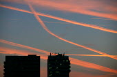 Vapor trails in the evening sky over London. - Justin Tallis - 2000s,2008,ace,aeroplane,aeroplanes,air,air pollution,air transport,aircraft,aircraft exhaust,airplane,airplanes,airspace,apartment,apartments,architecture,aviation,blocks,Blue Sky,building,buildings,