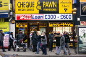 Pawnbroker, cheques cashed and speed loans. Wembley Central, London. - Justin Tallis - &,2000s,2008,Albemarle,asian,asians,bank,banking,banks,BME Black minority ethnic,Bond,borrower,borrowers,borrowing,bought,buy,buyer,buyers,buying,buys,capitalism,capitalist,cash,cashed,chair,cheques,c