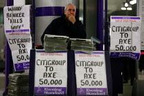 Newspaper headline Citigroup to Axe 50,000. Canary Wharf, London. - Justin Tallis - 2000s,2008,American,americans,axe,bank,banking,banks,buy,buyer,buyers,buying,citi,Citibank,cities,citigroup,city,commodities,commodity,company,Credit Crunch,crisis,cut,cuts,DOWNTURN,EARNINGS,EBF econo