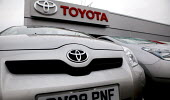 Toyota car Dealership in Warwickshire. - Justin Tallis - 2000s,2008,AUTO,auto industry,AUTOMOBILE,AUTOMOBILES,Automotive,automotive industry,badge,BADGES,bonnet,capitalism,capitalist,car,Car Industry,carindustry,cars,dealer,dealers,dealership,dealerships,de
