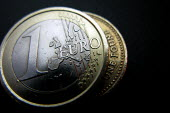 1 Euro and 1 Pound Coins. - Justin Tallis - ,1,2000s,2008,coin,coins,commerce,currency,EBF Economy,economic,economy,eu,euro,europe,european,europeans,euros,money,one,pound,pounds