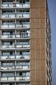People out on their balcony in sunny weather. High rise tower block in Bedford. - Justin Tallis - 2000s,2009,ACE,apartment,Apartments,architecture,balcony,blocks,buildings,council estate,council services,council estate,council services,culture,Deprivation,EQUALITY,estate,ESTATES,excluded,exclusion