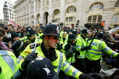 Protesters clash with riot police outside the Bank of England as thousands of demonstrators descended on the financial district ahead of the G20 summit. London. - Justin Tallis - 2000s,2009,activist,activists,adult,adults,against,anti,Bank,bank of England,BANKS,blood,bloody,CAMPAIGN,campaigner,campaigners,CAMPAIGNING,CAMPAIGNS,capitalism,capitalist,cities,city,CLJ,DEMONSTRATIN
