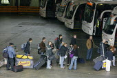 Migrants from Eastern Europe boarding a coach leaving for Poland as the recession reduces demand. London Victoria Coach Station. - Justin Tallis - 2000s,2009,back,bag,bags,BAME,BAMEs,BME,bmes,board,boarding,bus,bus service,buses,cities,city,coach,coaches,departing,departure,Diaspora,diversity,DOWNTURN,eastern European,EBF Economy,ethnic,ethnicit