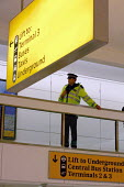 Police officer keeping an eye on things at London Heathrow Terminal One. - Justin Tallis - 16-05-2009