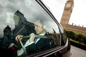 James Purnell MP driving away from Parliament on his mobile phone after attending his final Prime Ministers Questions before resigning from the cabinet, Westminster, London. - Justin Tallis - 03-06-2009