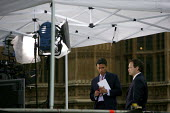 Matthew Amroliwala interviewing Grant Shapps MP outside of Westminster shortly after the cabinet reshuffle. - Justin Tallis - 05-06-2009