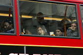 Commuters standing up on the top deck of a bus during the RMT tube strike. London Victoria Station. - Justin Tallis - 10-06-2009