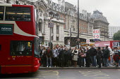 Crowds of commuters waiting for the bus outside London Victoria Station during the RMT tube strike. - Justin Tallis - 2000s,2009,adult,adults,bus,bus service,Bus Stop,buses,busy,cities,city,COMMUTE,commuter,commuters,commuting,crowd,crowded,disputes,EARNINGS,fed,FEMALE,from work,INDUSTRIAL DISPUTE,job,jobs,journey,jo