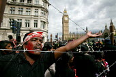 Re-enacting conditions in Jaffna Concentration Camp; Tens of thousands of Pro-Tamil Tiger demonstrators march through the streets of London to remember the thousands that died in the Sri Lankan war. - Justin Tallis - 20-06-2009