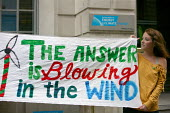 Climate change campaigners hold a banner outside the Department of Energy and Climate Change at a rally in support of occupying Vestas workers. Whitehall, London. - Justin Tallis - ,2000s,2009,activist,activists,alternative energy,CAMPAIGN,campaigner,campaigners,CAMPAIGNING,CAMPAIGNS,Climate Change,DEMONSTRATING,demonstration,DEMONSTRATIONS,Department,ENI environmental issues,FA