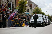 Hearses carrying the bodies of Rifleman Aminiasi Toge, 26, Capt Daniel Shepherd, 28, Cpl Joseph Etchells, 22 and Guardsman Christopher King, 20 travel along the High Street past silent mourners. Woott... - Justin Tallis - 28-07-2009