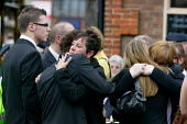 Mourners comfort each other as hearses carrying the bodies of Rifleman Aminiasi Toge, 26, Capt Daniel Shepherd, 28, Cpl Joseph Etchells, 22 and Guardsman Christopher King, 20 travel along the High Str... - Justin Tallis - 2000s,2009,action,afghan,Afghanistan,afghans,Armed Forces,army,British Army,carries,carry,carrying,ceremonies,ceremony,comfort,comforting,cries,cry,crying,cuddle,cuddling,dead,death,deaths,died,EARNIN