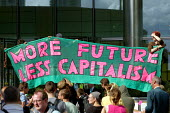 More Future, Less Capitalism. Climate Camp action outside Barclays Bank offices at Canary Wharf. London. - Justin Tallis - 2000s,2009,action,activist,activists,against,anti,anti capitalism,Bank,BANKS,Camp,CAMPAIGN,campaigner,campaigners,CAMPAIGNING,CAMPAIGNS,camps,capitalism,capitalist,civil disobedience,Climate,Climate C