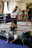 A young girl strapping up her hands to box. Times ABC Boxing Club. Islington, London - Justin Tallis - 27-08-2009