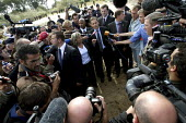 French Immigration Minister Eric Besson surrounded by the press whilst visiting the jungle area only a few hours after hundreds of refugees from Afghanistan were evicted. Calais, France. - Justin Tallis - 22-09-2009
