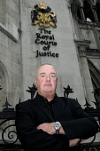 Blacklisted building worker Steve Acheson faces an Injunction under terrorism laws from Scottish & Southern Energy for protesting at Fiddlers Ferry power station. Outside the Royal Courts of Justice,... - Justin Tallis - 21-10-2009