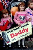 Children waving flags andwelcome home banners as the Second Battalion The Royal Regiment Of Fusiliers (2 RRF) return to their home base in Hounslow after a six months tour of duty in Afghanistan Helma... - Justin Tallis - 27-10-2009