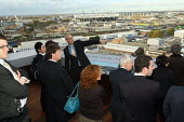 Potential investors and business people are shown the 2012 Olympic construction site and the London Thames Gateway - a panoramic view of the development and surrounding areas. East London. - Justin Tallis - 04-11-2009