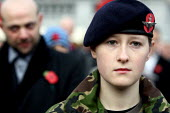 Young woman from Army Cadet Force of Buckinghamshire stands for a two minute silence at Armistice Day in Trafalgar Square. London. - Justin Tallis - 2000s,2009,ACF,ACFs,adolescence,adolescent,adolescents,Armed Forces,Armistice,army,Buckinghamshire,Cadet,cadets,child,CHILDHOOD,children,cities,city,COMMEMORATE,COMMEMORATING,commemoration,COMMEMORATI
