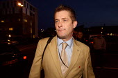 Richard Barnbrook BNP arriving at Barking Town Hall with Nick Griffin to give interviews to London evening news channels. Today Mr Griffin has launched his general election campaign in Barking, East L... - Justin Tallis - 19-11-2009
