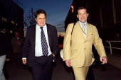 BNP leader Nick Griffin and Richard Barnbrook arriving at Barking Town Hall to give interviews to London evening news channels. Today Mr Griffin has launched his general election campaign in Barking,... - Justin Tallis - 19-11-2009
