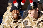 At ease having a laugh. Soldiers of the Second Battalion, the Royal Regiment of Fusiliers before they march through the streets after they have been granted the Freedom of the Borough. The regiment ha... - Justin Tallis - 26-11-2009