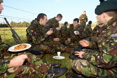 Reservists from London�s only Territorial Army Infantry Regiment, The London Regiment, having a lunch break after practicing pre-deployment training in preparation for operational service in Afghanist... - Justin Tallis - 2000s,2009,Armed Forces,army,break,british,Camaraderie,cities,city,dinner,dinners,DINNERTIME,down,Eat,eating,eats,EMOTION,EMOTIONAL,EMOTIONS,energy,exercise,exercises,field,food,FOODS,funny,grass,HAPP