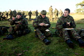 Reservists from London�s only Territorial Army Infantry Regiment, The London Regiment, having a lunch break after practicing pre-deployment training in preparation for operational service in Afghanist... - Justin Tallis - 2000s,2009,Armed Forces,army,break,british,cities,city,dinner,dinners,DINNERTIME,down,Eat,eating,eats,energy,exercise,exercises,field,food,FOODS,grass,Infantry,London,lunch,LUNCH BREAK,LUNCHBREAK,LUNC