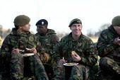 Reservists from the only Territorial Army Infantry Regiment in London, The London Regiment, having a lunch break after practicing pre-deployment training in preparation for operational service in Afgh... - Justin Tallis - 10-12-2009