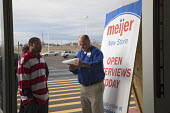A manager admits applicants to the store for interviews. Michigan - The unemployed of Detroit queue to apply for 200 jobs at a new Meijer store. - Jim West - 2010,2010s,African American,African Americans,African-American,America,application,apply,applying,BAME,BAMEs,black,BME,bmes,cultural,Detroit,diversity,DOWNTURN,EARNINGS,EBF,Economic,Economy,employee,e