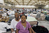 Baton Rouge, Louisiana. Samson Alexander in a Red Cross shelter at Baton Rouges Centroplex with his granddaughter, Keisha Lockett, 7, after they were forced out of New Orleans by Hurricane Katrina. - Jim West - 18-09-2005