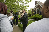 Detroit, Michigan - A home owned by a bank is auctioned by the Williams and Williams real estate auction company. The home foreclosure rate in the Detroit area is among the highest in the nation, due... - Jim West - 16-05-2007